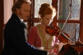 Gerda and The Lieutenant playing passionate duos on the violin